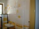 Rekonstrukce koupelen a bytových jáder v Kroměříži, Hulíně, Praze